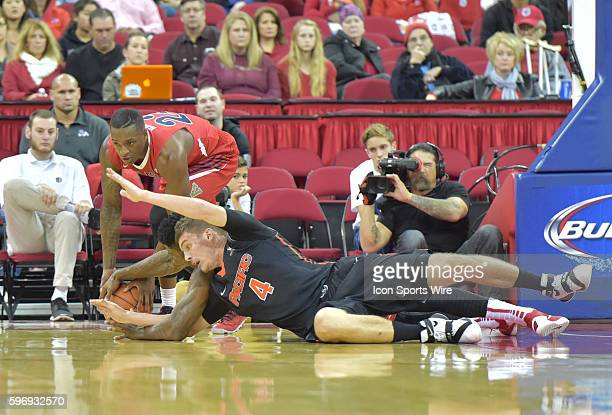 Fresno State Bulldogs guard Marvelle Harris and University of Pacific Tigers guard Aaron Hendricks struggle for the loose ball during the Fresno...