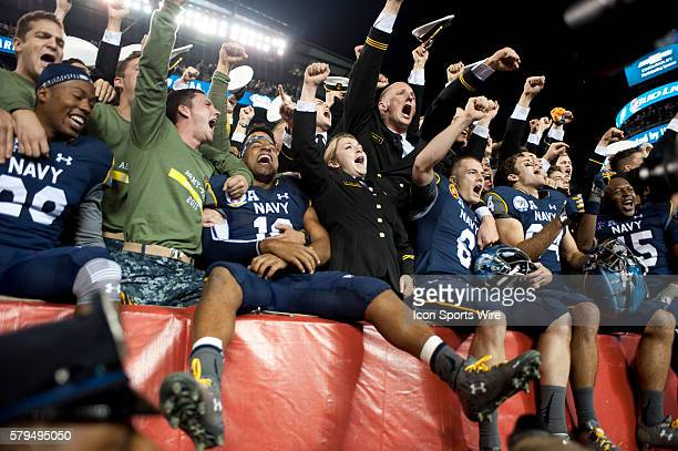 Navy players and fans celebrate their victory after the game between Army and Navy at Lincoln Financial Field in Philadelphia PA