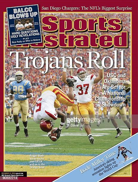 December 13, 2004 Sports Illustrated via Getty Images Cover: College Football: USC Reggie Bush in action and victorious, scoring 65 yard touchdown...