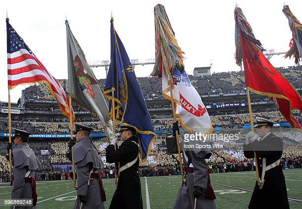 American and other military flags are displayed proudly in front of the fans before a match between Army and Navy at MT Bank Stadium in Baltimore...