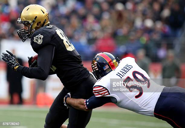Army wide receiver Edgar Poe runs by Navy linebacker Ryan Harris during a match between Army and Navy at MT Bank Stadium in Baltimore Maryland