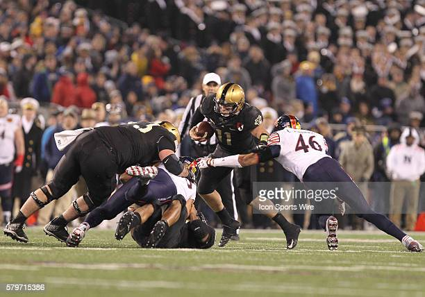 Navy's Outside Linebacker Chris Johnson sacks Army's Quarterback AJ Schurr for a 1 yard loss during 115th Army Navy football game between the Navy...