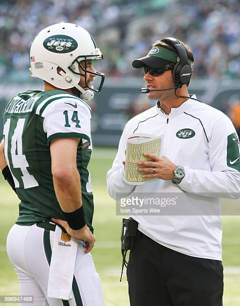 New York Jets Quarterback Ryan Fitzpatrick [7893] confers with Jets Quarterbacks Coach Kevin Patullo during the 1st half of the game between the...