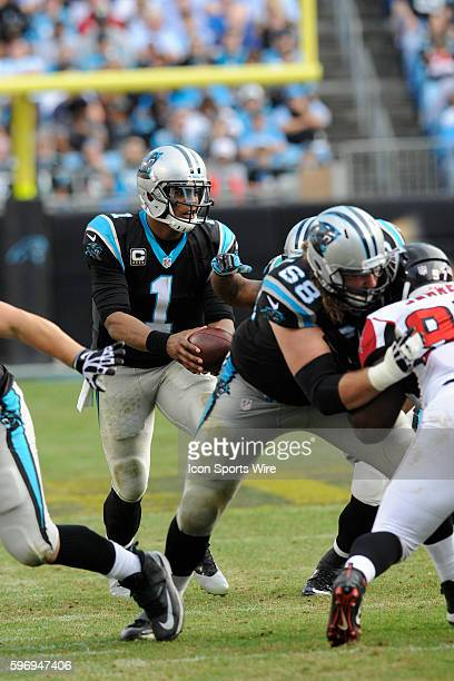 December 13   Sunday: Cam Newton QB Carolina Panthers hands the football off against the Atlanta Falcons in the NFL NFC South game at Bank of America...