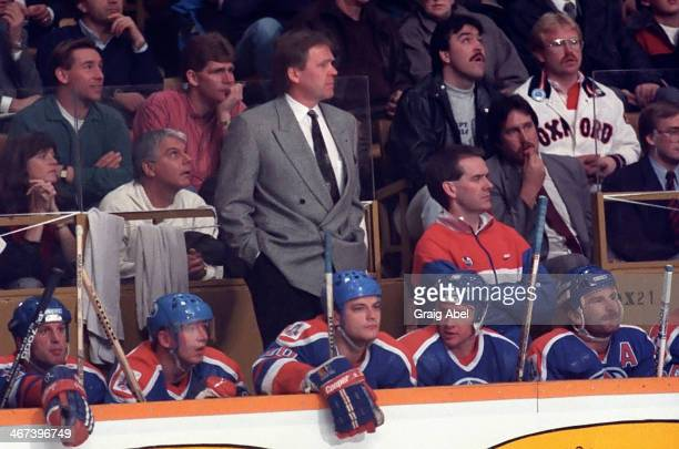 Coach Glen Sather of the Edmonton Oilers watches the play from behind the bench against the Toronto Maple Leafs on December 14 1988 at Maple Leaf...