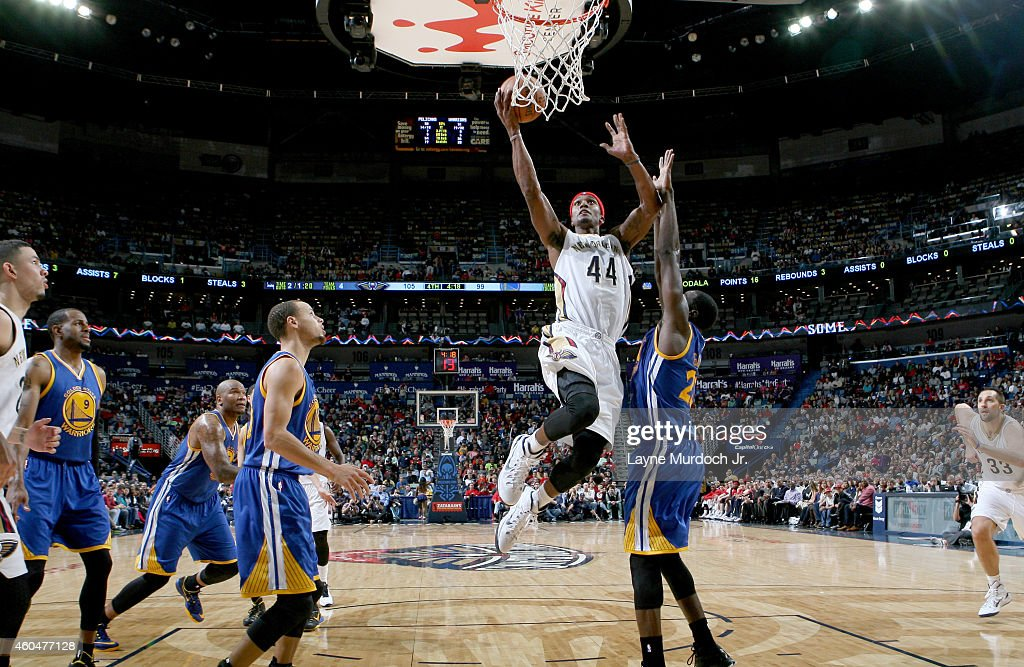 Dante Cunningham #44 of the New Orleans Pelicans goes for the dunk against the Golden State Warriors during the game on December 14, 2014 at Smoothie King Center in New Orleans, Louisiana.