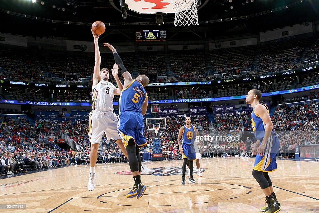 Jeff Withey #5 of the New Orleans Pelicans shoots over Marreese Speights #5 of the Golden State Warriors during the game on December 14, 2014 at Smoothie King Center in New Orleans, Louisiana.