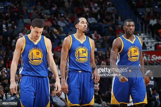 Klay Thompson Shaun Livingston and Festus Ezeli of the Golden State Warriors during the game against the New Orleans Pelicans on December 14 2014 at...