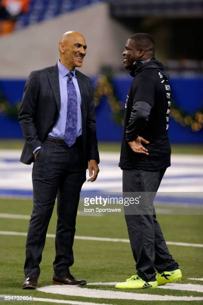 NFL analyst Tony Dungy talks with Indianapolis Colts running back Frank Gore prior to an NFL football game between the Denver Broncos and the...