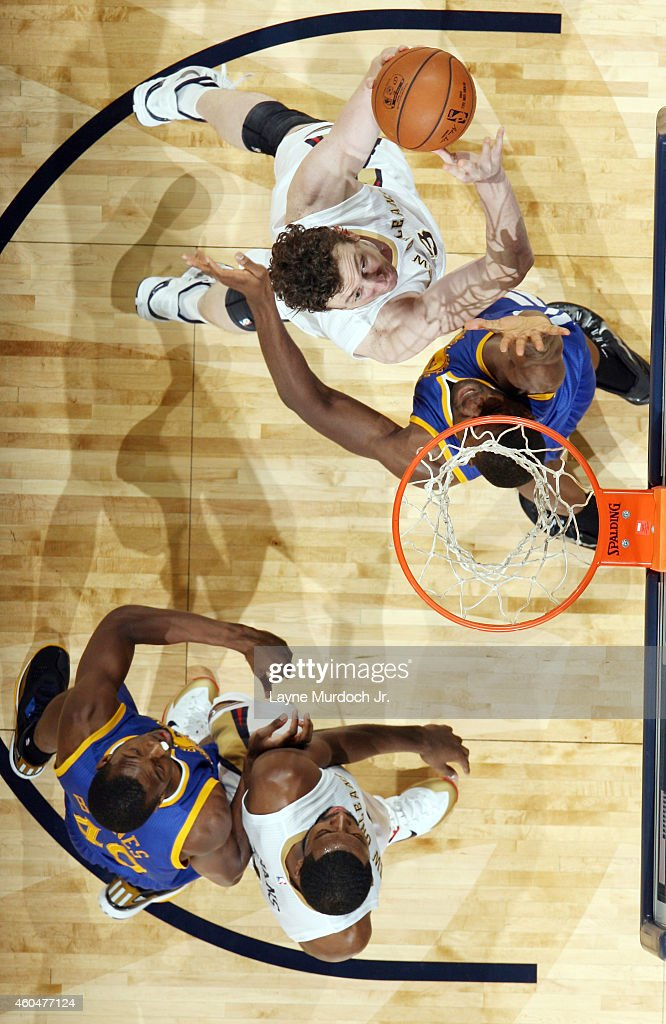 Omer Asik #3 of the New Orleans Pelicans goes for the layup against the Golden State Warriors during the game on December 14, 2014 at Smoothie King Center in New Orleans, Louisiana.