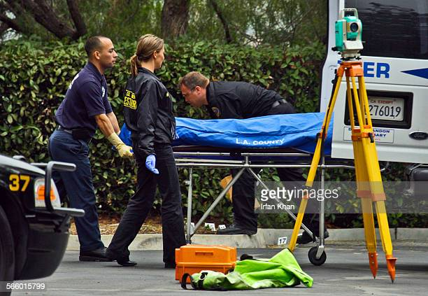 POMONA CA December 15 2010 Los Angeles County coroner removes one of two bodies Wednesday afternoon as Pomona police investigators work at the scene...
