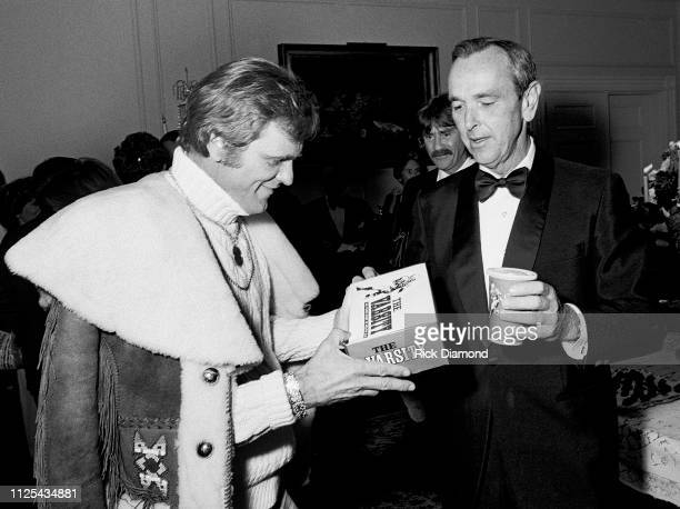 Jerry Reed gets Varisty Chilli Dogs from Governor George Busbee during Sharky's Machine World Premiere after party hosted by Governor George Busbee...