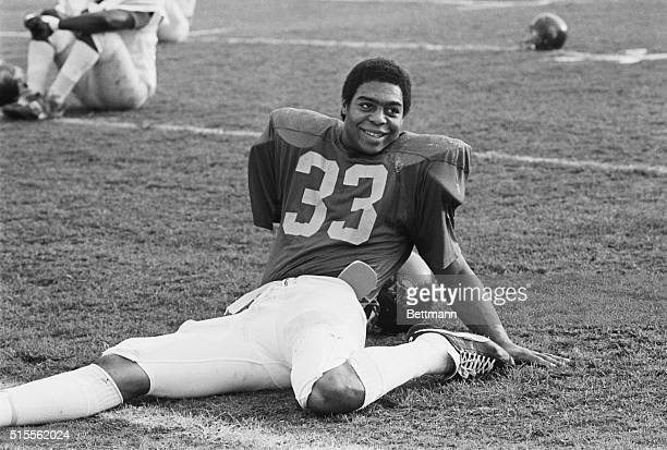 December 16 1981 Los Angeles Marcus Allen USC tailback stretches on the practice field at USC after being named 1981 UPI Player of the Year and...