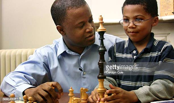 YORK December 16 2008––Maurice Ashley a chess grandmaster and the first African American to hold that title talks with his son Jayden age 6 Jayden...