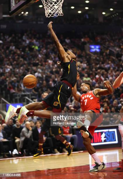 TORONTO ON December 16 In first half action Cleveland Cavaliers guard Collin Sexton loses the ball en route to the net as Toronto Raptors guard Kyle...