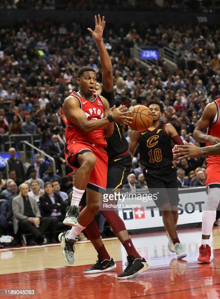 December 16 In second half action, Toronto Raptors guard Kyle Lowry passes the ball around some tight defence from Cleveland Cavaliers forward John...