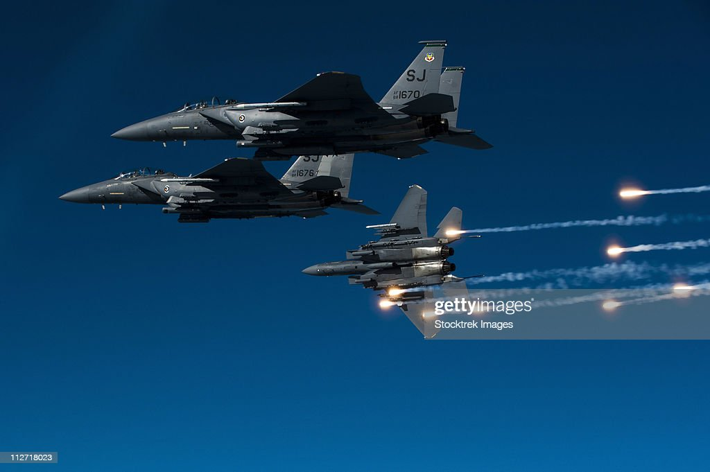 December 17, 2010 - A U.S. Air Force F-15E Strike Eagle aircraft releases flares during a local training mission over Seymour Johnson Air Force Base, North Carolina. : Stock Photo