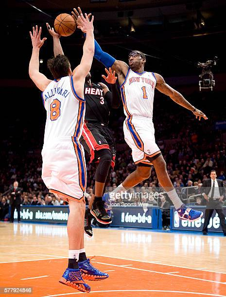 Miami Heat at New York Knicks at Madison Square Garden Knicks Danilo Gallinari and Amar'e Stoudemire double team Heat Dwyane Wade during the first...