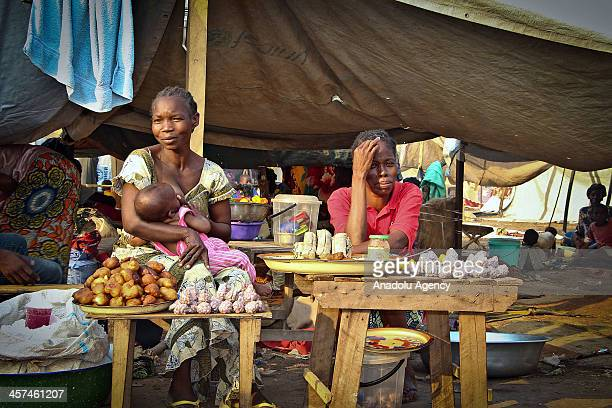 December 17 2013 dated pictures shows 40000 displaced people have sought refuge at Bangui airport following the recent bout of communal and sectarian...