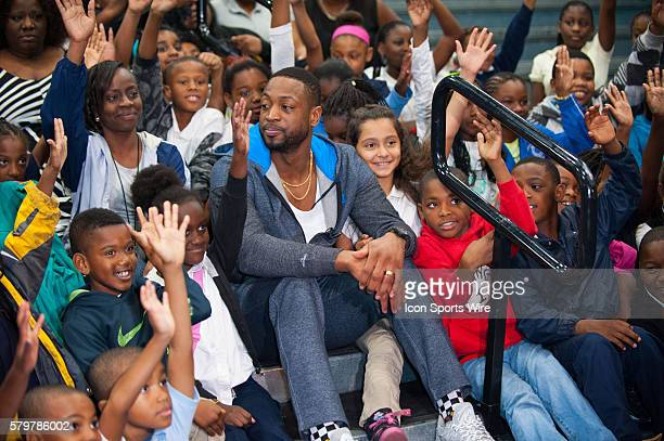 Dwyane Wade reads with children during Wade's World Foundation '3 Under the Tree' holiday event at Miami Children's Museum