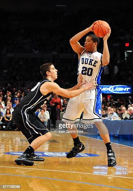 Duke guard Andre Dawkins looks to pass while guarded by Gonzaga guard Mike Hart during a game between the Gonzaga Bulldogs and the Duke Blue Devils...