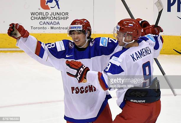 Russia forward Sergei Tolchinski is greeted by team mate Vladislav Kamenev after scoring on Canada in the second period of a tune up game for the...