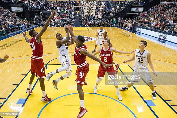 Indiana Hoosiers guard Robert Johnson blocks a shot by Notre Dame Fighting Irish guard Demetrius Jackson during the Crossroads Classic NCAA...
