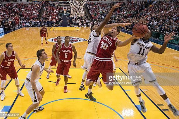 Notre Dame Fighting Irish guard Demetrius Jackson blocks a shot by Indiana Hoosiers forward Collin Hartman during the Crossroads Classic NCAA...