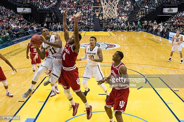 Notre Dame Fighting Irish guard Demetrius Jackson drives in the lane as Indiana Hoosiers guard Robert Johnson defends during the Crossroads Classic...