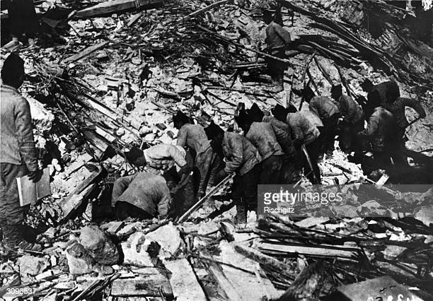People searching through the debris of Messina in Sicily after an earthquake that destroyed half the town and killed over 77000 people
