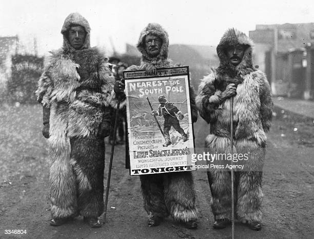 Men in arctic suits advertising the Shackleton Lantern Lecture which tells the story of Irish explorer Ernest Shackleton who came within a...