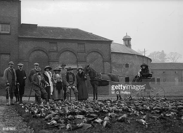 Members of a shooting party with their haul of pheasants after a shoot at Walcot Park Lyndbury in north Shropshire
