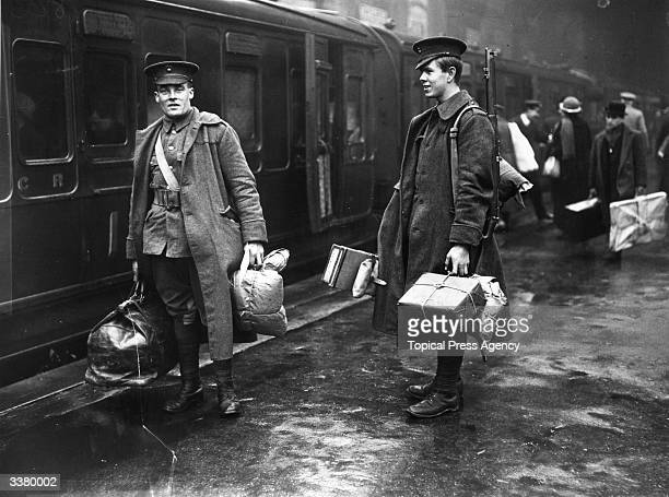 Two soldiers on the concourse at Victoria station London about to leave for the front line They are carrying parcels full of food and other provisions