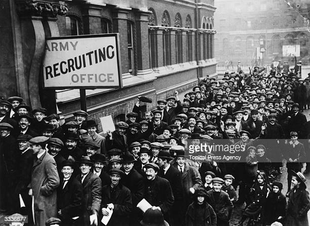A crowd of young men queuing up at the Army Recruiting Office at Southwark Hall south London during Lord Derby's recruitment campaign