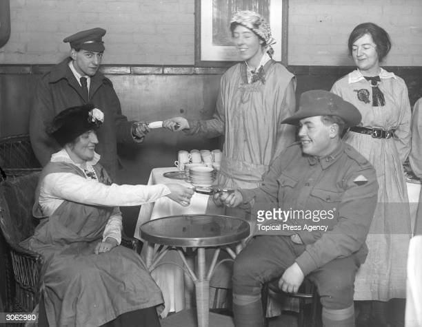 Australians pulling crackers during a tea party at an ANZAC buffet