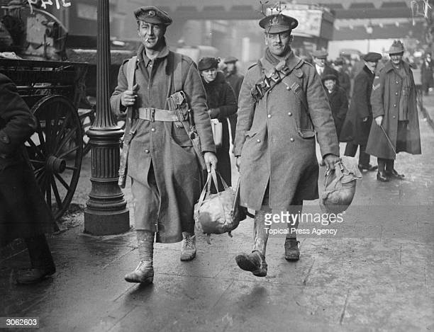 Soldiers arriving at a station in London to travel home for christmas.