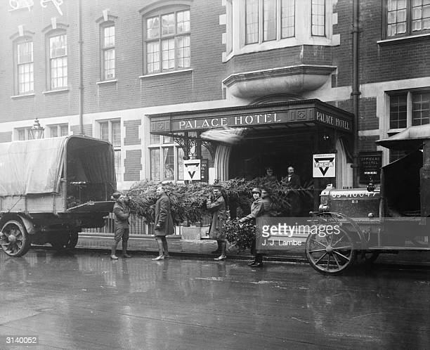 Christmas trees being delivered for the members of the American army staying at the Palace Hotel in London