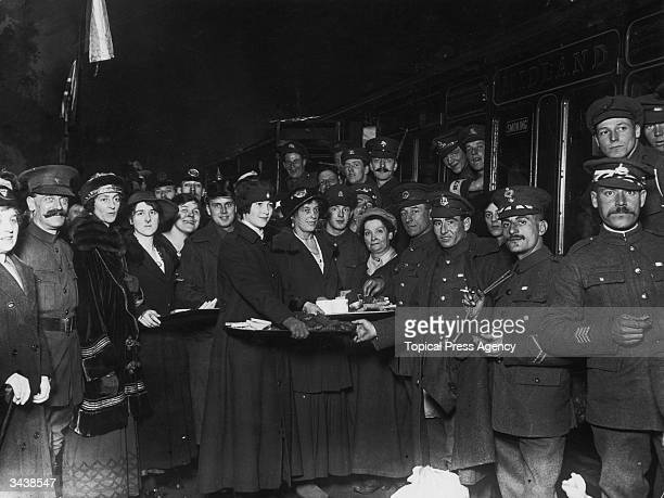 Liberated prisoners of war arriving at Cannon Street station, London, are welcomed with tea and biscuits.
