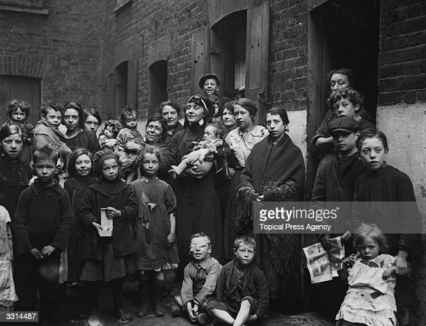 Nun Joan Conquest visits poor families in London's Shadwell