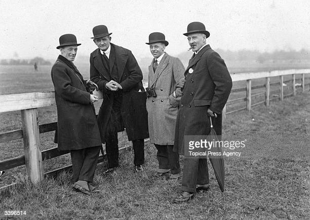 Spectators at the Cheltenham Steeplechases left to right Major Doyle Mr Geo De Vine Mr A B Doyale and Col Turner