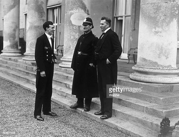 The Chief Steward C Taylor with the butler and Constable Walshe outside the Viceregal Lodge after the signing of the AngloIrish Treaty