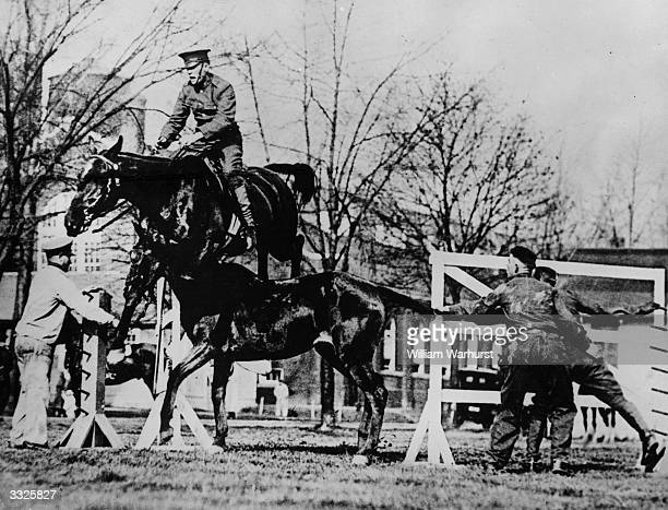 One horse leaps another during US Cavalry manoeuvres