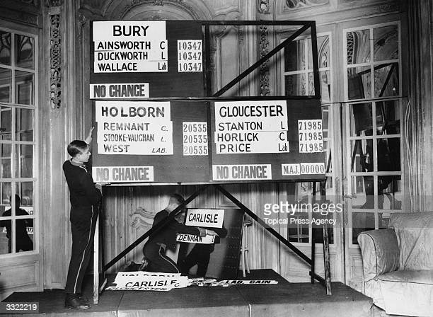 Two boys preparing the general election results board for broadcast at the Savoy Hotel, London.