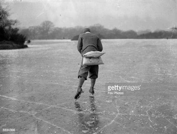 Skater not too sure of his abilities has padded himself with a cushion at a strategic point in case of a fall ! Hollow Ponds, Leytonstone, London had...