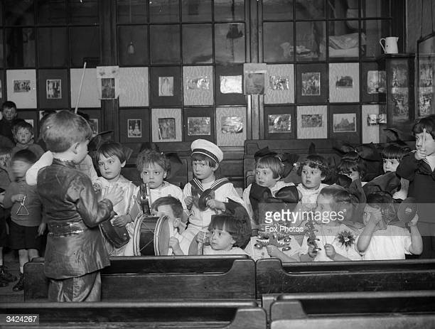 In their Christmas finery children of the kindergarten band at the White Lion Street school