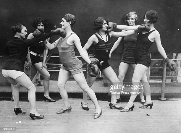 A group of women mockboxing