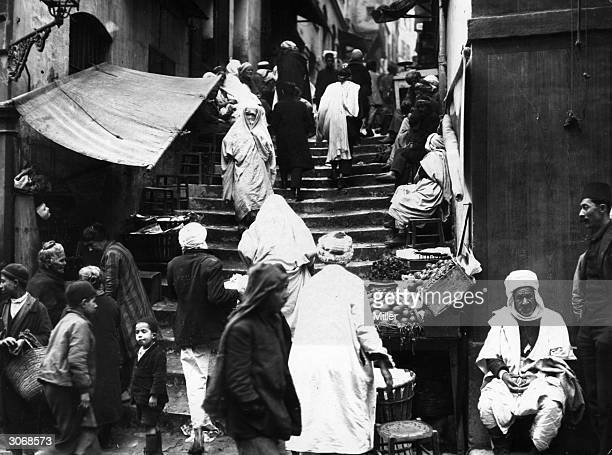Traders selling their goods on steps in the Casbah Algiers