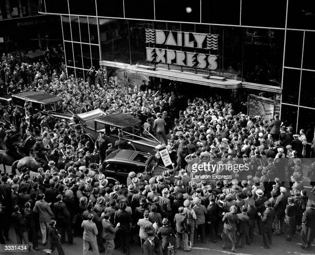Crowds gather round the entrance to the Daily Express building Fleet Street London to greet English aviator Amy Johnson after her record solo flight...