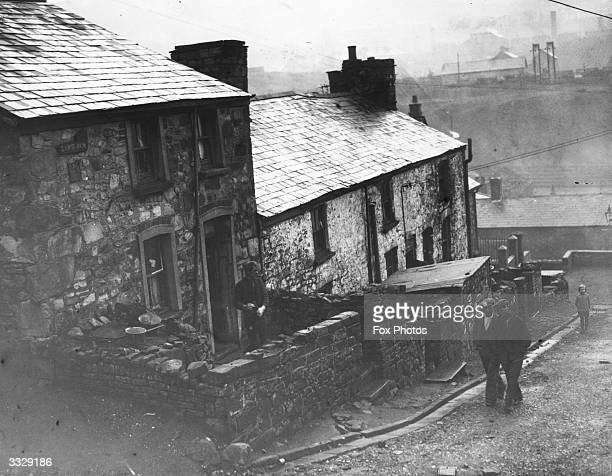 Miners and miners' cottages at Ebbw Vale in South Wales
