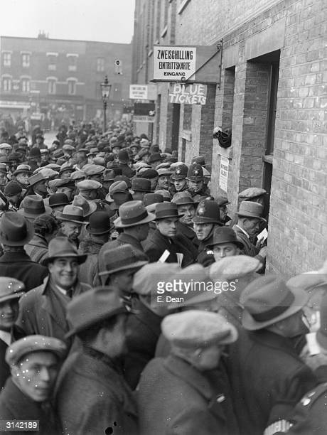 German fans move through the turnstyles at White Hart Lane Tottenham London for the England v Germany football match
